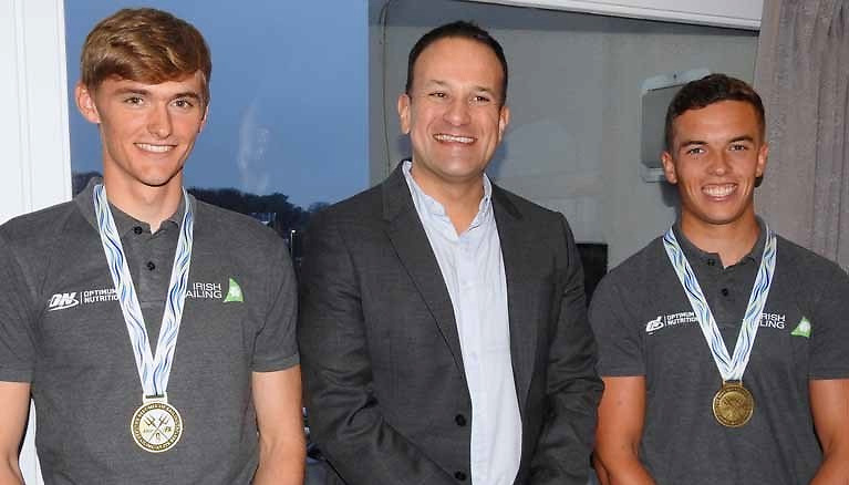 Rob Dickson, Taoiseach Leo Varadkar and Sean Waddilove in Howth Yacht Club after Rob and Sean had won the 49er U23 Worlds in September 2018.