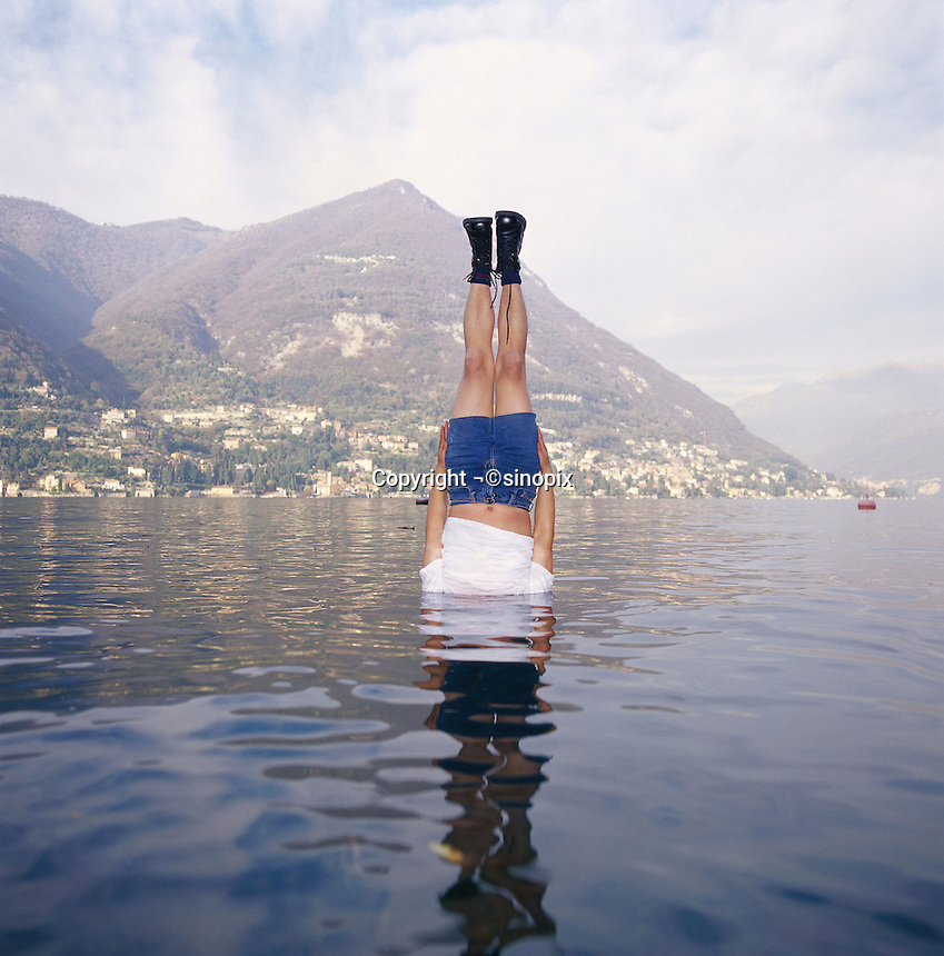 "Li Wei artwork named ""Liwei falls to the Como lake, Italy"" ...PHOTO BY SINOPIX"