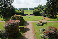 Gravelled pathways divide the manicured lawns of the garden which features a number of rhododendron bushes