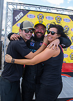 Oct 30, 2016; Las Vegas, NV, USA; NHRA pro stock driver Shane Gray (center) celebrates with son Tanner Gray and wife Amber Gray after winning the Toyota Nationals at The Strip at Las Vegas Motor Speedway. Mandatory Credit: Mark J. Rebilas-USA TODAY Sports