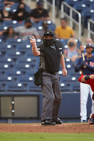 Umpire Greg Gibson calls a strike during a Major League Spring Training game between the Washington Nationals and Houston Astros on March 19, 2021 at The Ballpark of the Palm Beaches in Palm Beach, Florida.  (Mike Janes/Four Seam Images)