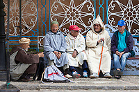Chefchaouen, Morocco.  Men Talking in the Public Square, Demonstrating a Variety of Traditional and Western Clothing Styles.