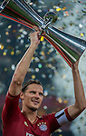 Daniel Van Buyten of Bayern Munich holds the trophy after winning a friendly match against VfL Wolfsburg as part of the Audi Football Summit 2012 on July 26, 2012 at the Guangdong Olympic Sports Center in Guangzhou, China. Photo by Victor Fraile / The Power of Sport Images