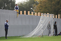 A Real Romania players takes up an unusual vantage point during a Hackney & Leyton Sunday League match at Hackney Marshes - 25/10/09 - MANDATORY CREDIT: Gavin Ellis/TGSPHOTO - Self billing applies where appropriate - Tel: 0845 094 6026