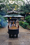 prayer and burning incense at Six Banyon Tree Temple in city of Guangzhou, China, Asia