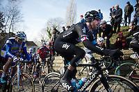 Sir Bradley Wiggins (GBR/Sky) over the cobbles of the infamous Muur van Geraardsbergen<br /> <br /> Omloop Het Nieuwsblad 2015