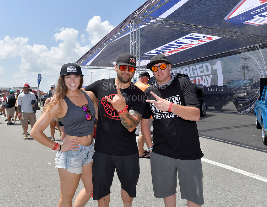 DAYTONA BEACH, FL - SEPTEMBER 05:  Gabby Stubbs, World Record Holder Joe Sylvester (Bad Habit Monster Truck sets a new world record, jumps 237-ft, 6-inches) , Jason Sandusky at the 2020 Daytona Truck Meet which is The LARGEST truck show in the world! PRESENTED BY AMERICAN FORCE WHEELS with over 35,000 spectators, 100s of vendors, burn out pit, and live entertainment. Trucks are all the rage with Celebrities like Shaquille O'Neal, Lady GaGa, Dwayne Johnson and Kid Rock just to name a few at Daytona International Speedway on September 5, 2020 in Daytona Beach, Florida.<br /> <br /> People:  Gabby Stubbs, Joe Sylvester, Jason Sandusky