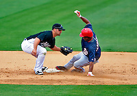 16 March 2009: Florida Marlins' infielder Dan Uggla catches Anderson Hernandez stealing during a Spring Training game against the Washington Nationals at Roger Dean Stadium in Jupiter, Florida. The Nationals defeated the Marlins 3-1 in the Grapefruit League matchup. Mandatory Photo Credit: Ed Wolfstein Photo