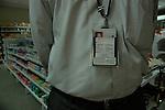 An Indian software professional wearing an identity card of Progeon company, at a shoping mall in Bangalore, Karnataka, India. Arindam Mukherjee