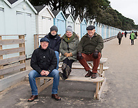 BNPS.co.uk (01202 558833)<br /> Pic: PhilYeomans/BNPS<br /> <br /> The first 4 hardy souls have started early to get the beach hut of their dreams.<br /> <br /> We will fight them for the beach huts...<br /> <br /> A group of hardy souls queued up a day early in the freezing cold to secure a sought-after beach hut for the summer.<br /> <br /> They have gone to extreme lengths to snap up the 15 timber cabins available at Avon Beach, Christchurch, Dorset.<br /> <br /> The first in the queue, Jan Ryder, was in position at 6.15am on Sunday, almost 26 hours before the administration office opened at 7.30am today.<br /> <br /> By the mid-morning, the group had already swelled to half a dozen who sat on deckchairs and sipped on tea while wrapped in blankets.<br /> <br /> Matthew Cox, 60, a mechanical engineer, was in position just before 7am. He remembers being taken to the beach by his late mother Margaret as a child and has queued up each year for a hut since her passing three years ago.