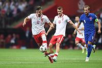 8th September 2021; PGE National Stadium, Warsaw, Poland: FIFA World Cup 2022 Football qualification, Poland versus England;  Jakub Moder turns away from Harry Kane