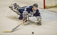 4 January 2014:  Yale University Bulldog goaltender Alex Lyon, a Freshman from Baudette, MN, clears a third period rebound against the University of Vermont Catamounts at Gutterson Fieldhouse in Burlington, Vermont. With an empty net and seconds remaining, the Cats came back to tie the game 3-3 against the 10th seeded Bulldogs. Mandatory Credit: Ed Wolfstein Photo *** RAW (NEF) Image File Available ***