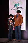 Rodee Owen DeMers during the bareback and saddle bronc back  number  presentation at the Junior World Finals Rodeo. Photo by Andy Watson. Written permission must be  provided  to use  this  photo  in any manner.