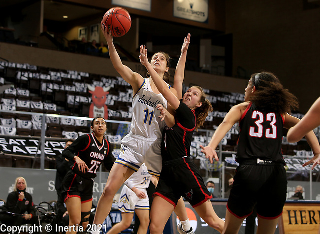 SIOUX FALLS, SD - MARCH 6: Haley Greer #11 of the South Dakota State Jackrabbits lays the ball up against Sarah Schmitt #1 of the Omaha Mavericks during the Summit League Basketball Tournament at the Sanford Pentagon in Sioux Falls, SD. (Photo by Dave Eggen/Inertia)