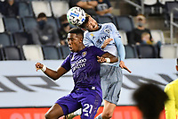 KANSAS CITY, KS - SEPTEMBER 23: Ilie Sanchez #6 of Sporting Kansas City wins the aerial battle with Andres Perea #21 of Orlando City during a game between Orlando City SC and Sporting Kansas City at Children's Mercy Park on September 23, 2020 in Kansas City, Kansas.