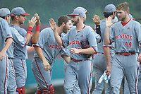 North Carolina State Wolfpack starting pitcher Brian Brown (38) high fives his teammates following the win over the Northeastern Huskies at Doak Field at Dail Park on June 2, 2018 in Raleigh, North Carolina. The Wolfpack defeated the Huskies 9-2. (Brian Westerholt/Four Seam Images)