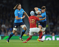 Michele Campagnaro of Italy attempts to evade the grasp of Alexandre Dumoulin of France during Match 5 of the Rugby World Cup 2015 between France and Italy - 19/09/2015 - Twickenham Stadium, London <br /> Mandatory Credit: Rob Munro/Stewart Communications