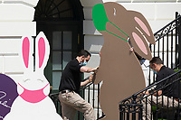 Decorations depicting Easter bunnies wearing face masks are seen at the South Portico steps of the White House before US President Joe Biden (not pictured) delivered remarks regarding Easter, in Washington, DC, USA, 05 April 2021. The traditional Easter Egg Roll at the White House with thousands of visitors was not held due to the coronavirus COVID-19 pandemic.<br /> Credit: Michael Reynolds / Pool via CNP /MediaPunch
