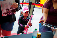 Sep 1, 2019; Clermont, IN, USA; A young female child at NHRA qualifying for the US Nationals at Lucas Oil Raceway. Mandatory Credit: Mark J. Rebilas-USA TODAY Sports