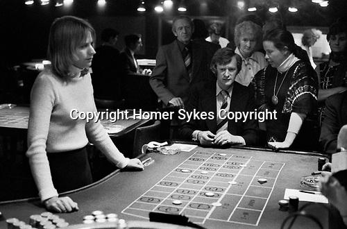 Casino interior Isle of Man 1970s, people playing roulette  gambling 1978 UK.