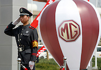 A Chinese guard stands near a balloon displaying a MG logo at the launching ceremony of the first Chinese built MG vehicles in Nanjing, China. The Chinese company is now in a position to take on Rover's assets and plan its future. It intended to relocate the engine plant and some car production plant to China but to retain some car production plant in the UK..27 Mar 2007