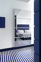 The blue and white decorative theme is carried through into each of the twelve bedrooms with floors covered in striped ceramic tiles