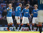 Nicky Law points to team mate Nicky Clark after scoring the final goal for Rangers