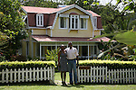 Lyton and Eroline Lamontagne, owners of Fond Doux Estate, posing in front of Angelina cottage..