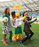 Artists Carlinhos Brown, Ivete Sangalo, Wyclef Jean, Carlos Santana and Alexandre Pires pose on the Maracana pitch ahead of tomorrow's FIFA World Cup Final, Germany vs Argentina where they will perform at the closing ceremony