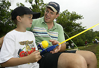 Joshua (6) Haudek and his father Todd, of Beaver Creek, fish together during a fishing derby Saturday, June 11, 2005, in Bellbrook, Ohio.