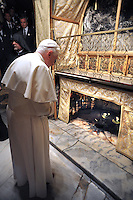 Pope Benedict XVI,prays in the grotto where tradition holds Jesus was born, in the Church of the Nativity, in the West Bank town of Bethlehem, Wednesday, May 13, 2009..
