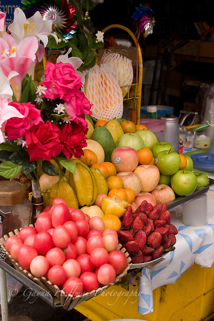 Flowers and fruit stand. Bangkok, Thailand