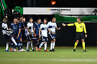 LAKE BUENA VISTA, FL - JULY 26: Referee Victor Rivas directs players during a game between Vancouver Whitecaps and Sporting Kansas City at ESPN Wide World of Sports on July 26, 2020 in Lake Buena Vista, Florida.