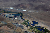 aerial photograph of the power plants along the Truckee River, Barrick Gold power plant in the foreground, Reno Apple Data Center in the background, Sparks,  Nevada