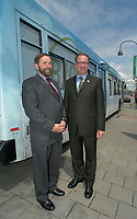 may 27, 2003, Montreal, Quebec, Canada.<br /> <br /> Thomas J Mulcair, Quebec new Environment Minister(L) and Claude Dauphin, Director Montreal Transit Commision (R),pose with one of the  buses that ran on  Bio Diesel, in a trial use  for the last 6 months,<br />  by the Transit Commission in Montreal  (Soci»t» de Transport de Montr»al)<br /> after a press confrence,May 28, 2003.<br /> <br /> If done on a regular basis, it would help reduce pollution by city buses.<br /> <br /> <br /> Mandatory Credit: Photo by Pierre Roussel- Images Distribution. (©) Copyright 2003 by Pierre Roussel <br />  - Mulcair is now (2011) with the New Democratic Party (of Canada).  - Claude Dauphin