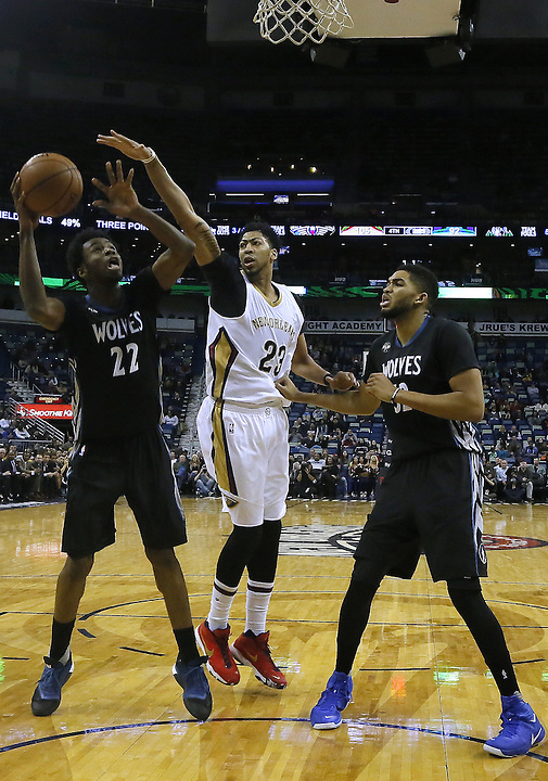 Minnesota Timberwolves guard Andrew Wiggins (22) shoots over New Orleans Pelicans forward Anthony Davis (23) during the second half of an NBA basketball game Tuesday, Jan. 19, 2016, in New Orleans. The Pelicans won 114-99.(AP Photo/Jonathan Bachman)