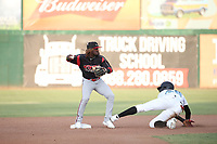 Jordy Barley (8) of the Lake Elsinore Storm throws to first base after getting the force out at second base during a game against the Inland Empire 66ers at San Manuel Stadium on July 25, 2021 in San Bernardino, California. (Larry Goren/Four Seam Images)