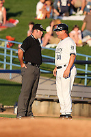 West Michigan Whitecaps manager Joe DePastino (31) argues a call with umpire Matt Deane during a game vs. the South Bend Silver Hawks at Fifth Third Field in Comstock Park, Michigan August 16, 2010.   West Michigan defeated South Bend 3-2.  Photo By Mike Janes/Four Seam Images