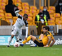 Fulham's Ademola Lookman (left) is tackled by Wolverhampton Wanderers' Ruben Neves (right) <br /> <br /> Photographer David Horton/CameraSport<br /> <br /> The Premier League - Wolverhampton Wanderers v Fulham - Sunday 4th October 2020 - Molineux Stadium - Wolverhampton<br /> <br /> World Copyright © 2020 CameraSport. All rights reserved. 43 Linden Ave. Countesthorpe. Leicester. England. LE8 5PG - Tel: +44 (0) 116 277 4147 - admin@camerasport.com - www.camerasport.com