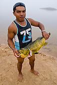 Pará State, Brazil. Xingu River. Gilson with Tucunare fish.