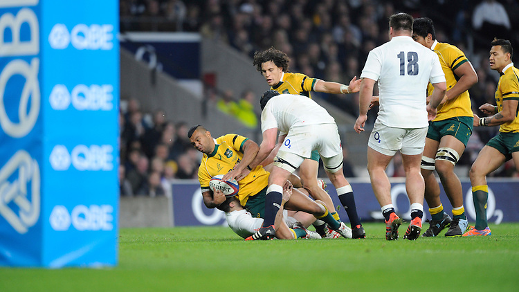 Kurtley Beale of Australia is stopped short of the line during the QBE International match between England and Australia at Twickenham Stadium on Saturday 29th November 2014 (Photo by Rob Munro)