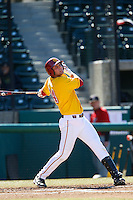 Vahn Bozoian #14 of the USC Trojans bats against the Cal State Northridge Matadors at Dedeaux Field on February 24, 2013 in Los Angeles, California. (Larry Goren/Four Seam Images)