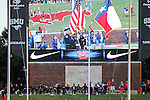 A group of fans kneel during the National Anthem before the game between the TCU Horned Frogs and the SMU Mustangs at the Gerald J. Ford Stadium in Dallas, Texas.