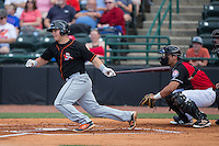 Alex Murphy (32) of the Delmarva Shorebirds follows through on his swing against the Hickory Crawdads at L.P. Frans Stadium on June 18, 2016 in Hickory, North Carolina.  The Crawdads defeated the Shorebirds 1-0 in game one of a double-header.  (Brian Westerholt/Four Seam Images)