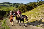 Arron Lazanoff and son Ethan riding horseback at sunset, San Luis Obispo, California