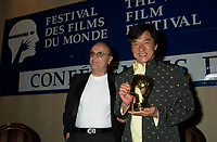 2001 file Photo -HK actor and director Jackie Chan   receive a Special Grand Prize of the Americas, from <br /> Montreal World Film Festival's President & founder ; <br /> Serge Losique, Sept 1st , 2001 in Montreal, CANADA.