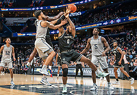 WASHINGTON, DC - FEBRUARY 19: Maliek White #4 and Nate Watson #0 of Providence bttle for possession with Jahvon Blair #0 of Georgetown during a game between Providence and Georgetown at Capital One Arena on February 19, 2020 in Washington, DC.