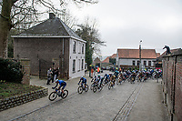 "Tim Declercq ""El tractor"" (BEL/Deceuninck - Quick Step)  leading Davide Ballerini (ITA/Deceuninck - QuickStep) & World Champion Julian Alaphilippe (FRA/Deceuninck - QuickStep)over the cobbles<br /> <br /> 76th Omloop Het Nieuwsblad 2021<br /> ME(1.UWT)<br /> 1 day race from Ghent to Ninove (BEL): 200km<br /> <br /> ©kramon"