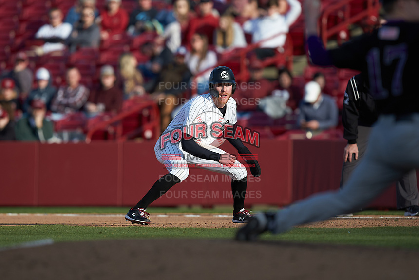 Noah Myers (9) of the South Carolina Gamecocks takes his lead off of first base against the Holy Cross Crusaders at Founders Park on February 15, 2020 in Columbia, South Carolina. The Gamecocks defeated the Crusaders 9-4.  (Brian Westerholt/Four Seam Images)