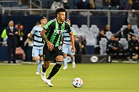 KANSAS CITY, KS - MAY 9: Julio Cascante #18 Austin FC with the ball during a game between Austin FC and Sporting Kansas City at Children's Mercy Park on May 9, 2021 in Kansas City, Kansas.